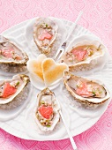 Fresh oysters on a plate of sea salt with heart-shaped toast