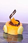 Orange cake with chocolate and macaroons