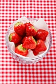 Fresh strawberries on a napkin in a glass bowl