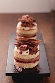 Chocolate tartlets with cream and redcurrants