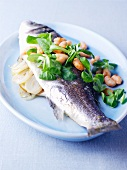 Sea bass with white beans, leek and lamb's lettuce