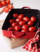 Tomatoes being roasted in a roasting tin