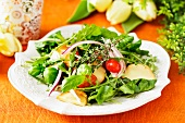 Spinach salad with smoked cheese for Easter