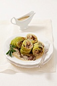 Savoy cabbage roulade with barley and mushrooms