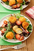 Potato croquettes with Roquefort on a mixed leaf salad