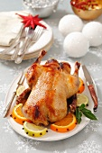 Roast duck with oranges for Christmas dinner