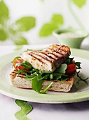 A sword fish, rocket and tomato sandwich