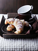 Chocolate croissants and coffee cups