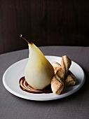 Poached pears with chocolate sauce and puff pastry cakes