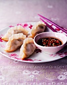 Dumplings with a spicy sauce