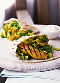 Pita filled with grilled chicken and salad