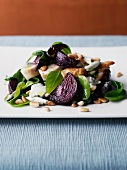 Chicken salad with beetroot, baby spinach and pine nuts