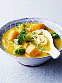 Curry and coconut soup with vegetables