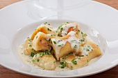 Potato Paunzen (Austrian dumplings) with a cream sauce and chives