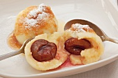 Plum dumplings with buttered breadcrumbs and icing sugar