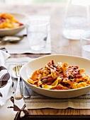 Pasta alla puttanesca (pasta with a spicy tomato sauce)