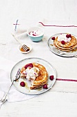 Pancakes with raspberries, ricotta and maple syrup