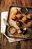 Bombolini (Italian doughnuts with cinnamon sugar and chocolate sauce)