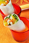 Rice paper rolls filled with vegetables and oranges