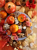 A Christmas arrangement of biscuits and fruit