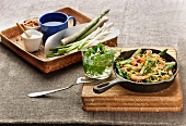 Spaghetti with prawns, asparagus, pine nuts and herbs