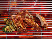 Spare ribs on a grill with vegetables