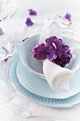 A place setting decorated with hydrangea