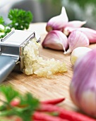 Garlic with a garlic crusher