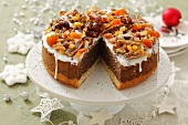 Poppy seed cake with icing, dried fruits and nuts for Christmas