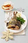 Fried carp with herbs for Christmas