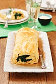 Cheese roll (goat cheese, Parmesan) with spinach