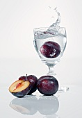 A damson falling into a schnapps glass