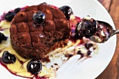 Tartufo cake with liquid chocolate, vanilla sauce and cherries