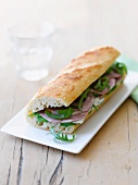 Baguette sandwich with lamb and rocket