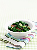 Spinach with bacon and spring onions