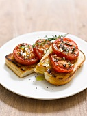 Toast topped with tomatoes and thyme