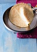 Pancake in a frying pan