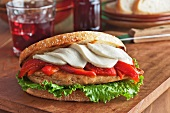 Grilled Chicken Breast Sandwich with Roasted Red Peppers, Mozzarella Cheese and Lettuce on Grilled Tuscan Boule Bread