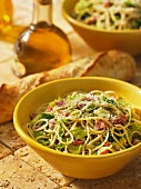 Spaghetti with savoy cabbage and pancetta, baguette and olive oil
