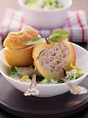 Baked apples filled with sausage meat on a bed of savoy cabbage with horseradish cream