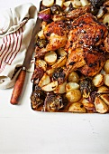 Oven-roasted pepper chicken with potatoes and onions