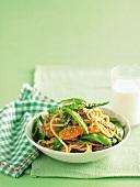 Hokkien noodles with pork, mange tout, carrots and sesame