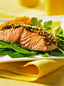 Salmon with a pistachio crust on a bed of mange tout and asparagus