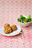 Fried vegetable balls with a side salad