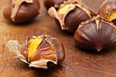 Roasted chestnuts on a wooden board