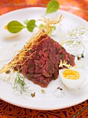 Oriental beef tatar with boiled egg