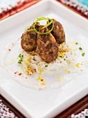 Minced meat and bulgur dumplings on a radish salad