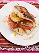 Fried trout with tomatoes on yogurt sauce with zatar