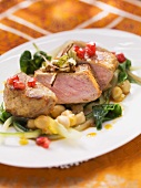 Medium rare saddle of veal on a bed of chard and chickpeas