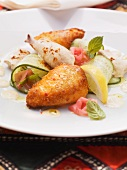 Chicken, prepared in two different ways with a cucumber and ginger salad